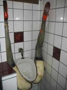 Urinal Legs in the air